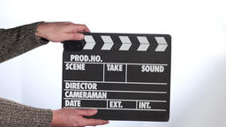 Close up of male hand holding movie clapperboard Footage