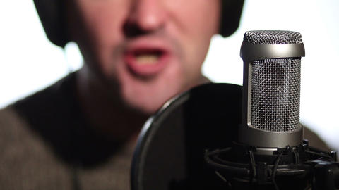 Close up man singing into a condenser microphone Live Action