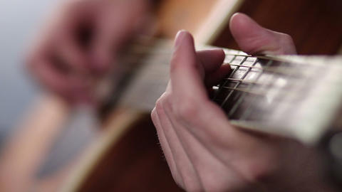 Man's fingers playing on guitar frets Footage