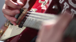 Man playing electric guitar using tremolo technique Footage