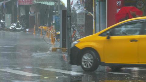 Pedestrian struggles to cross street in typhoon wind and rain 影片素材