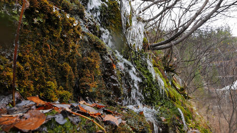The stream flows through the wall of the quarry. Russia Footage