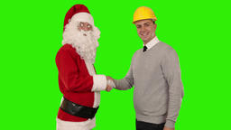 Santa Claus and Young Architect shaking hands and looking at camera, Green Scree Footage