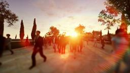 Crowd walking at sunset, camera flying Animation