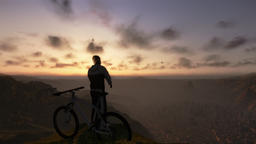 Cyclist on top of the mountain, timelapse sunset, tilt up Animation