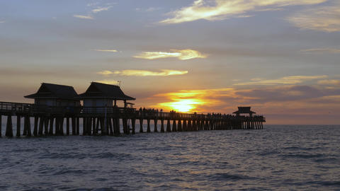 Beautiful sunset over ocean, with silhouette of pier ライブ動画
