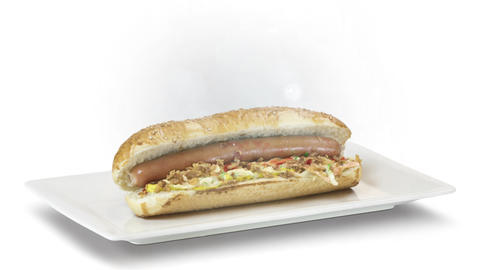 Hot dogs with a sausage on a fresh rolls with ketchup on white plate on white background Live Action