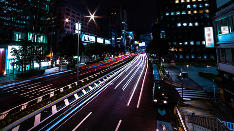 A night timelapse of the urban city street in Aoyama wide shot panning Live Action