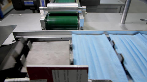 protective masks without bands transported by conveyor Live Action