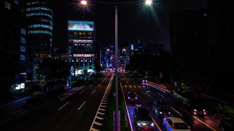 A night timelapse of the urban city street in Aoyama wide shot tilt Live Action