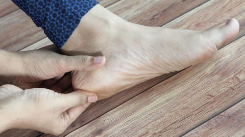 Woman Touching Foot In Pain Close Up Live Action