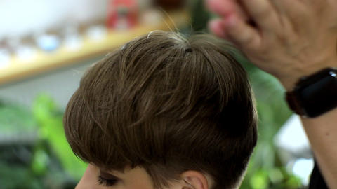 Close-up of hands doing a hairstyle. Closeup of professional hairdresser hands Live Action