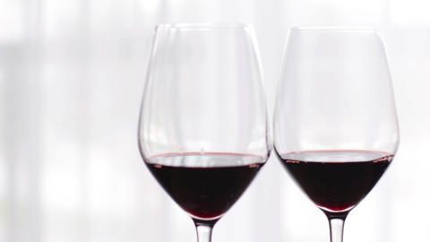 Romantic drink for two, glasses of red wine indoors at wine-tasting event Live Action