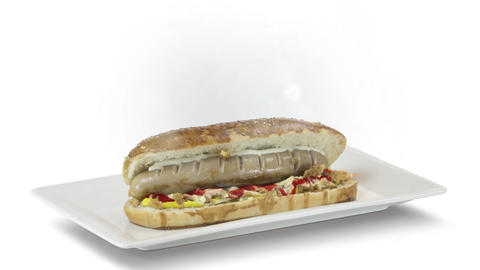 Hot dog with a sausage on a fresh rolls with ketchup on white plate on white background Live Action