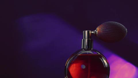 Vintage perfume bottle and shining light flares on dark background, glamorous Live Action