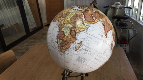 Retro globe item decorated on table Live Action
