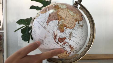 Hand dial retro globe item Live Action