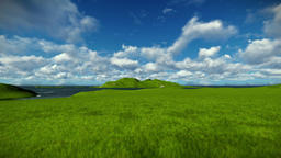 Green meadow and ocean against beautiful timelapse clouds Animation
