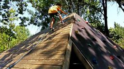 Little boy climbing Footage