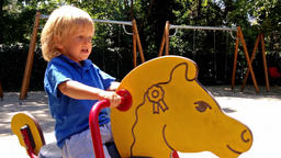 Little boy ridding a toy horse Footage