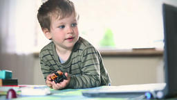 Little boy watching cartoons on laptop Footage