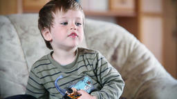 Little boy watching TV, front view Footage
