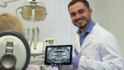 Dentist approves tooth health on the x-ray Live Action