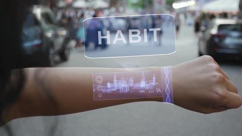 Female hand activates hologram Habit Live Action