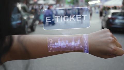 Female hand activates hologram E-ticket Live Action