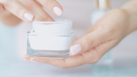 Skincare product at spa, face or hand cream jar for healthy skin care routine Live Action