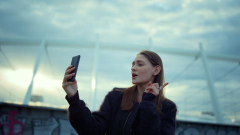 Girl making self video on cellphone for blog. Girl video calling on smartphone Live Action