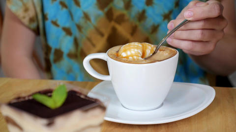 Woman Drinking a Cup Of Cappuccino Coffee With Thick Froth Live Action
