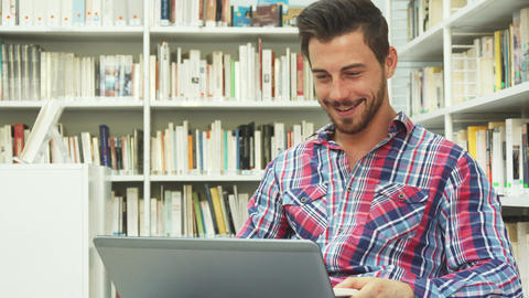 Cheerful guy looks at laptop and laughs Live Action