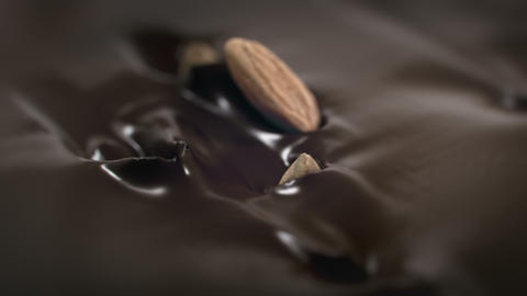 Almonds Nuts Splash Into Liquid Chocolate in 4K Super slow motion GIF