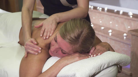 Professional girl doing a woman relaxing back massage Live Action