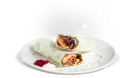 Turkish traditional doner wrap meat on white plate on white background Live Action
