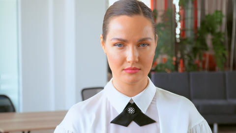 portrait focused entrepreneur in elegant shirt in office Live Action