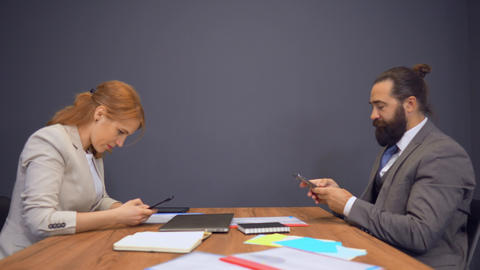 business people sitting in meeting room using devices Live Action