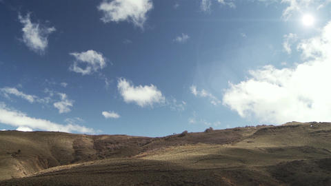 The Sun Shining over a Hill with Blue Cloudy Sky in Patagonia, Argentina, South America Live Action
