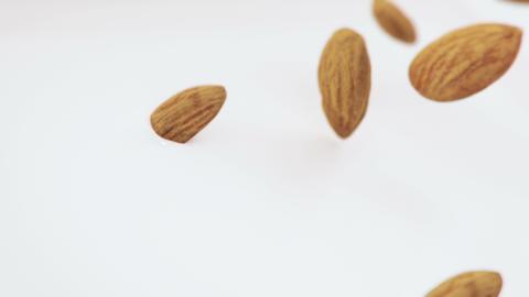 Almonds Nuts Splash Into Liquid Cream in 4K Super slow motion GIF