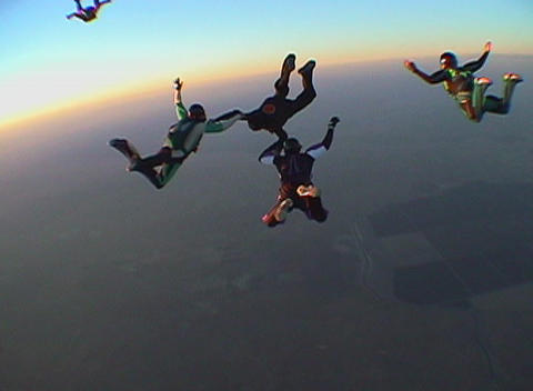 Ten skydivers jump out of an airplane and free fall Stock Video Footage