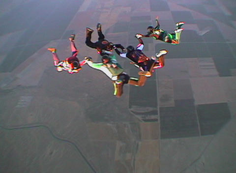 Ten skydivers jump out of an airplane and free fall Footage
