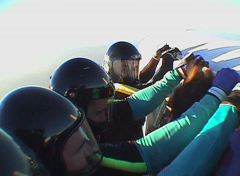 Five skydivers jump out of an airplane and free fall Stock Video Footage