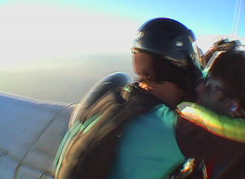 Five skydivers jump out of an airplane and free fall Footage