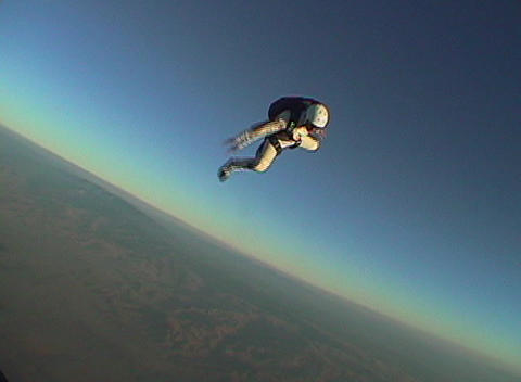 A skydiver jumps from an airplane and free falls out of... Stock Video Footage