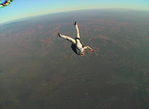 A skydiver jumps from an airplane and free falls out of control Footage