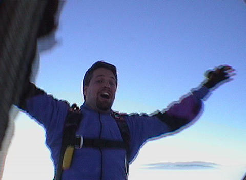 A skydiver falls backwards from a hot air balloon Stock Video Footage