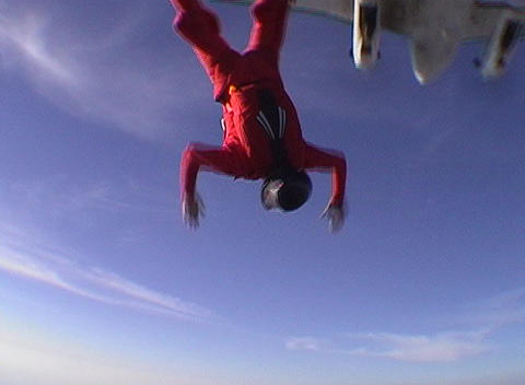 A skydiver jumps from an airplane and free falls Stock Video Footage