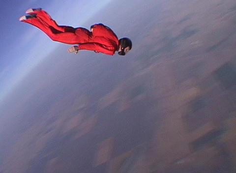 A skydiver jumps from an airplane and free falls Live Action
