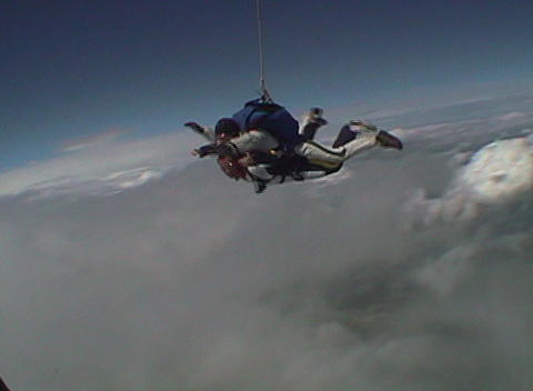 Tandem skydivers barrel roll out of an airplane and free fall Footage